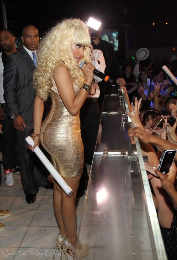 Nicki Minaj in gold tight dress performs in Las Vegas-08