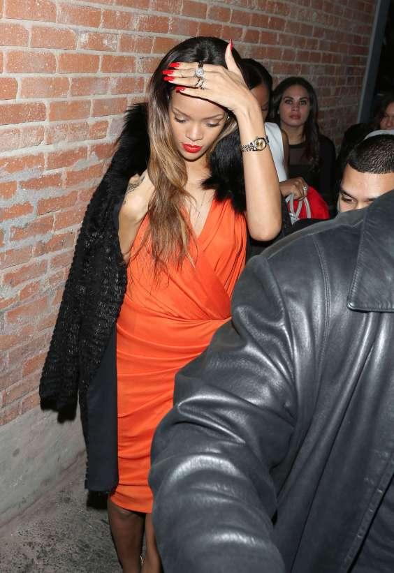 Rihanna-in-orange-dress-08